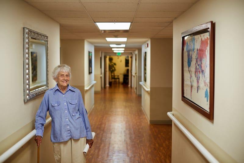 senior resident smiling in the hall