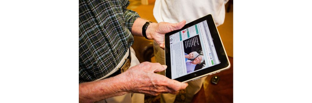 senior resident using an ipad